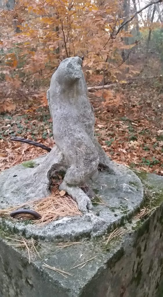 A decapitated angel stands sentry at the foot of the Olmsted estate in Massachusetts.