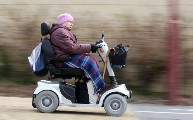 Old woman going really fast on a mobility scooter